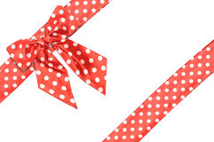 Dotted red satin gift bow and ribbon Royalty Free Stock Images