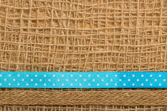 Dotted ribbon on burlap cloth background Stock Photos