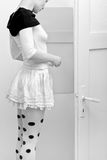 Dotted tights. Woman in dotted tights and white skirt stock images