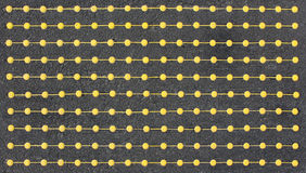 Dotted Yellow Lines. Pattern on a rough surface Royalty Free Stock Photos