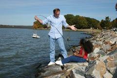 dotterfader som fiskar det interracial fotografimaterielet Royaltyfria Bilder