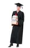 Dottorando in manto con i libri Fotografia Stock