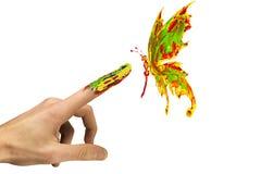 Dotyk między malującym motylem i palcem Obrazy Stock