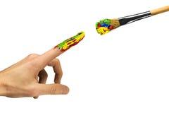 Dotyk między palcem i paintbrush Zdjęcie Stock