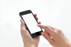 Dotykać na smartphone z pustym ekranem Zdjęcia Stock