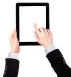 Dotyka ekranu pastylki komputer z ręką obrazy royalty free