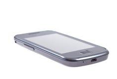 Dotyka ekranu telefon komórkowy na odosobnionym Zdjęcia Royalty Free