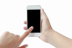 Dotyka ekranu telefon komórkowy w ręce odizolowywającej na białym tle Obraz Royalty Free