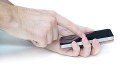 Dotyka ekranu telefon komórkowy w rękach na bielu Zdjęcia Royalty Free