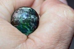 Dotyka ziemię z palcem, elementy ten wizerunek meblujący NASA zdjęcie stock