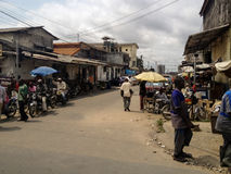 Douala, Cameroon. Unidentified people on thje street of Douala, Cameroon. With more than 3 million inhabitants it is a largest city in Cameroon and its stock image