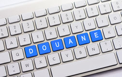 DOUANE writing on white keyboard Royalty Free Stock Photos