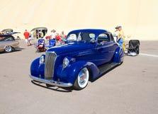 Douaneauto: 1937 mompelt Chevy met Seat Stock Foto