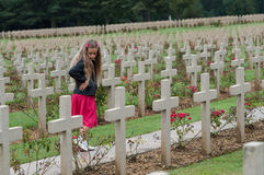 Douaumont Ossuaire Memorial. A girl walking among graves of soldier from the World War I at the Douaumont Ossuaire memorial Royalty Free Stock Image