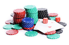 Double aces with big stack and dice over white Royalty Free Stock Images