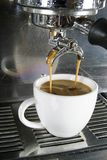 Double Americano. Being drawn from a professional espresso machine Royalty Free Stock Photo