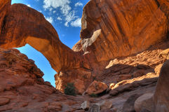 Double Arch. High Dynamic Range Photo of a Double Arch against blue sky-  Moab Utah Stock Photo