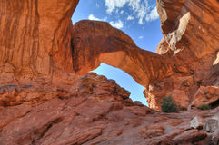 Double Arch. High Dynamic Range Photo of a Double Arch against blue sky-  Moab Utah Royalty Free Stock Image