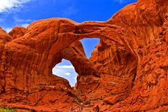 Double Arch at Arches National Park. People marching up Double Arch in Arches National Park, Moab, Utah on a beautiful spring day Royalty Free Stock Images
