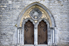 Double arched wooden doors Stock Photos