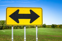 Double Arrow Traffic Sign and Blue Sky Royalty Free Stock Images