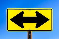 Double Arrow Yellow Traffic Sign Stock Images