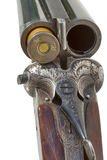 Double barrel old shotgun with one cartridge Stock Images
