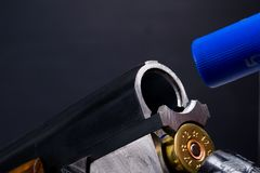 Double-barreled gun on a black background, charged with a blue cartridge royalty free stock photography