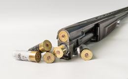 Double-barreled hunting gun with cartridges on a light background Royalty Free Stock Photography