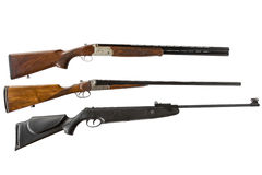 Double-barreled shotguns and air gun isolated on white background Royalty Free Stock Photos