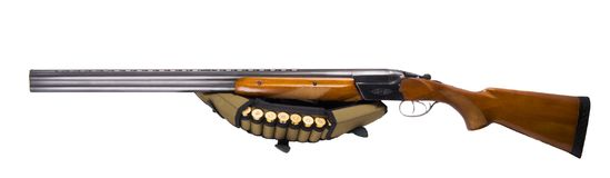 Double-barreled weapon with patronage and ammunition, on a white background stock image
