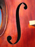 Double-bass body. F-hole detail of a double-bass Stock Photos