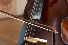 Double bass. Contrabass with bow musical instrument. Closeup cello royalty free stock image
