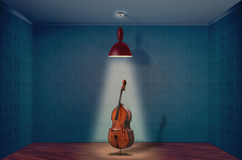 Double Bass. A Double Bass On A empty room Stock Photos
