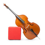 Double bass leans against red box Stock Photography