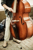 Double bass performer. Street artist performing double bass royalty free stock photo