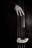 Double bass player. 's hand in black and white Royalty Free Stock Images