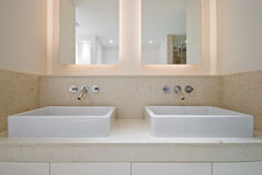Double bathroom sink. Double ceramic bathroom sink and double mirror with natural stone tiles Stock Photography