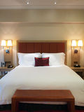 Double bed. In hotel room Royalty Free Stock Images