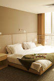 Double bed. Near the window Royalty Free Stock Images