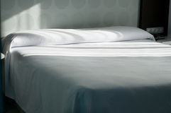 Double bed in apartment Stock Images