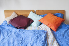 Double bed with bedding Stock Photography
