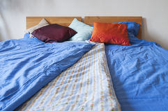 Double bed with bedding Stock Photos