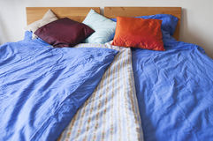 Double bed with bedding Stock Images