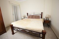 Double bed in a bedroom Stock Photography