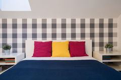 Double bed with color cushions Royalty Free Stock Photography