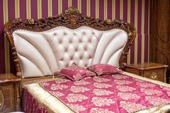 Double bed with decorative headboard Stock Photo