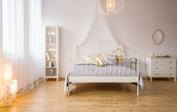 Double bed and decorative lighting Stock Photos