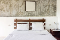 Double bed and furniture with picture frame. The bed room is hotel room Stock Images