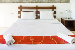 Double bed and furniture for relaxation Stock Photos